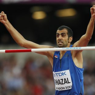 Syria's Majd Eddin Ghazal celebrates after an attempt in the men's high jump final during the World Athletics Championships in London Sunday, Aug. 13, 2017. (AP Photo/Kirsty Wigglesworth)