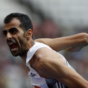 Syria's Majd Eddin Ghazal celebrates as he clears 230 in the Men's High Jump event during the the IAAF Diamond League Anniversary Games athletics meeting at the London Stadium in London on July 21, 2019. (Photo by Adrian DENNIS / AFP)ADRIAN DENNIS/AFP/Getty Images
